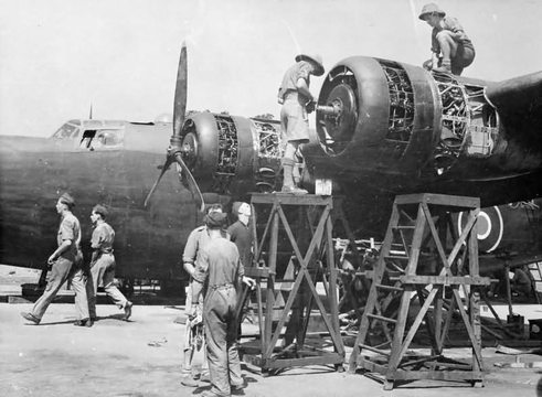 Normal mechanics servicing the pratt  whitney twin wasp radial engines of a liberator mk ii of no 159 squadron raf at salbani india