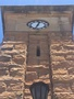 Thumb close up of clock and light on one side of the memorial   coonabarabran war memorial clock tower
