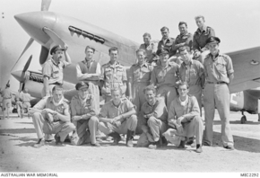 Profile pic awm mec2292  malta. c. july 1943. group portrait of members of no. 3 squadron raaf in front of their curtiss p40 kittyhawk aircraft.