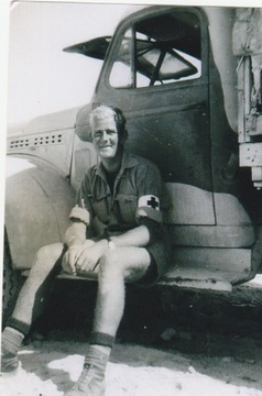 Profile pic dad sitting on truck