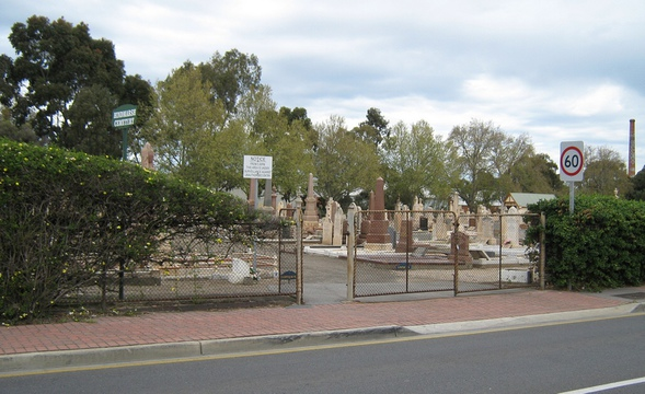 Normal hindmarsh cemetery   entrance from adam st   with brickwork markets chimney  in background