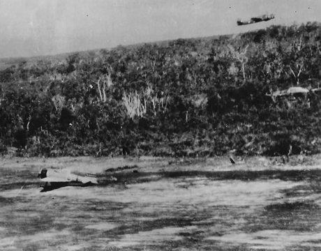 Normal raaf beaufighter strafes japanese zero on kai island 1943