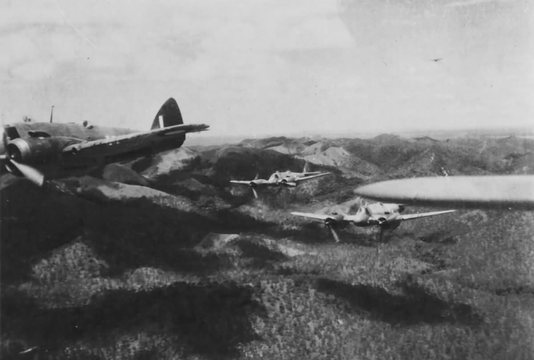 Normal beaufighters of the royal australian air force fly over the finschhafen area