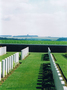 Thumb bouzincourt ridge cemetery entry  from inside the cemetery   view to thiepval memorial in horizon